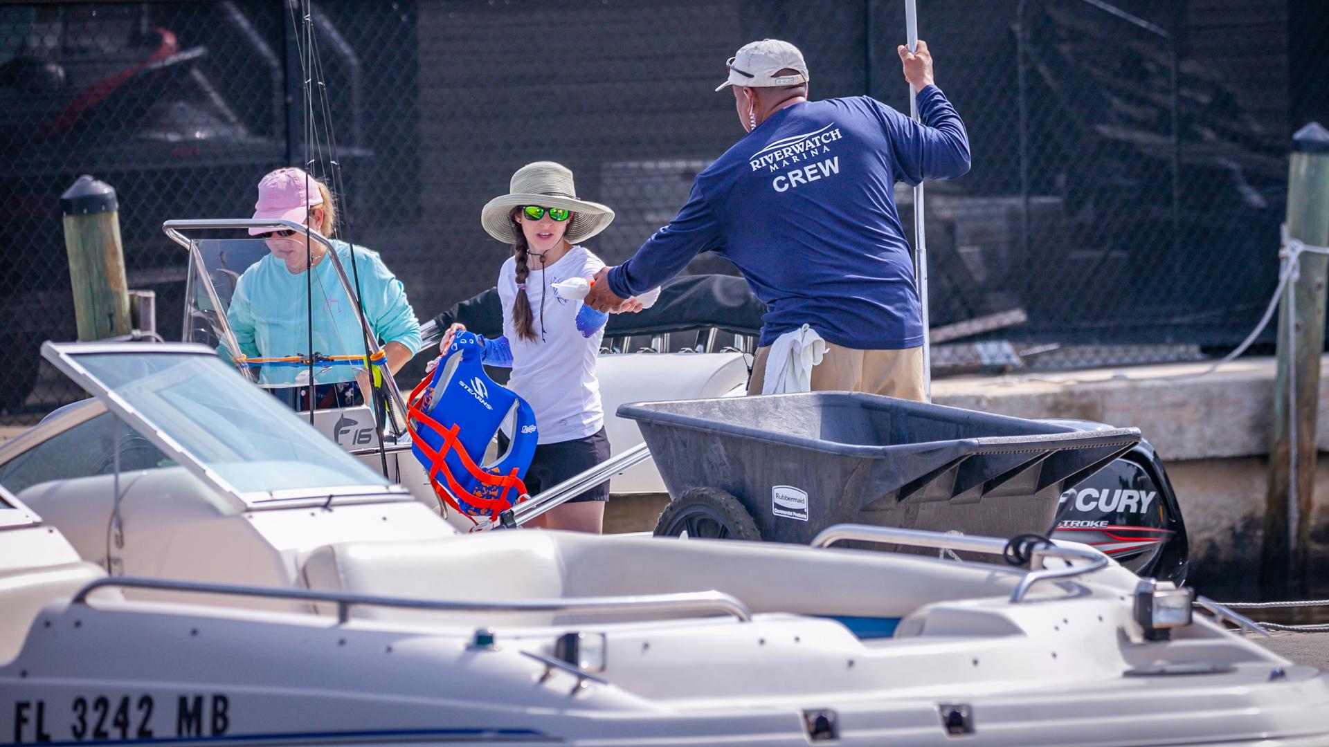 Riverwatch Marina Crew Member Helping Boaters